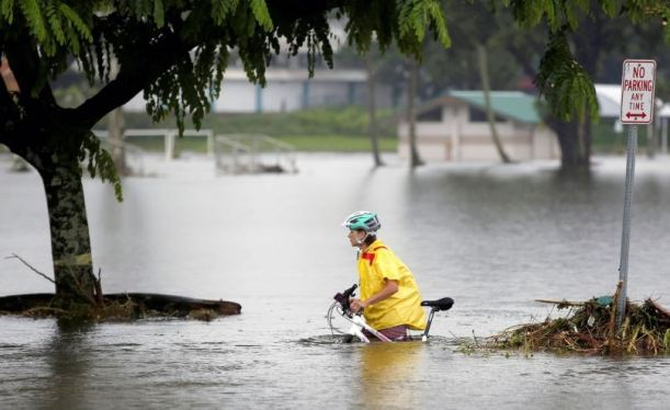 pushing bike in floods